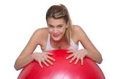 Stock Photo of fitness - young woman with exercise ball on white