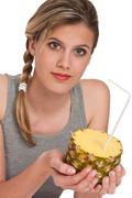 Stock Photo of healthy lifestyle series - woman holding pineapple