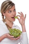healthy lifestyle series - woman eating kiwi - stock photo