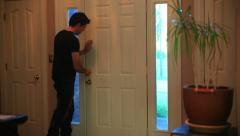 Coming home opening door walking in Stock Footage