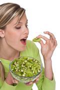 Stock Photo of healthy lifestyle series - woman eating kiwi