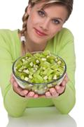healthy lifestyle series - woman holding bowl of kiwi - stock photo