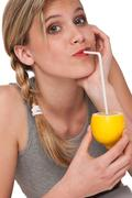 healthy lifestyle series - woman holding lemon - stock photo