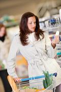 Shopping series - young brunette buying deodorant Stock Photos