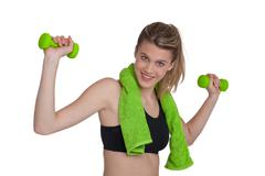 Fitness - young sportive woman exercise with weights Stock Photos