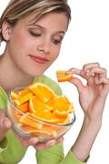 Stock Photo of healthy lifestyle series - woman with orange