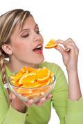 Stock Photo of healthy lifestyle series - woman eating orange