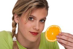 Stock Photo of healthy lifestyle series - woman holding slice of orange