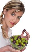 Stock Photo of healthy lifestyle series - woman with grapes