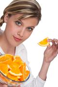 Healthy lifestyle series - blond woman with oranges Stock Photos