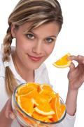 Healthy lifestyle series - woman holding orange Stock Photos