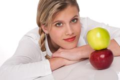 Healthy lifestyle series - portrait of woman with two apples Stock Photos