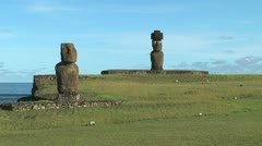 Easter Island Tahai Complex two moai worn face and top hat 9 Stock Footage