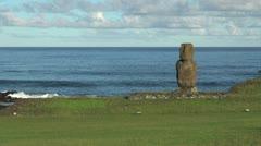 Easter Island wave rolls behind Ahu Tahai 5b Stock Footage