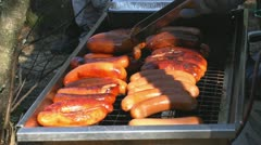 Cooking sausages in outdoor grill 1 Stock Footage