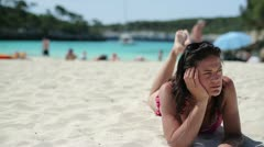 Pensive woman lying on the beach, dolly shot Stock Footage