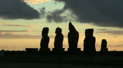 Easter Island Ahu Vai Ure sunset outlines moai group 6 Stock Footage