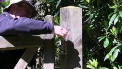 A walker using a gate on the Brown Clee Stock Footage