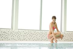 swimming pool - beautiful woman in bikini - stock photo