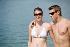 happy couple in swimwear at sea in summer - stock photo