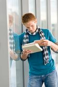 Male teenager read book Stock Photos