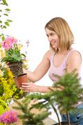 Stock Photo of gardening - happy woman holding flower pot