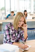 happy smiling student study in classroom at university - stock photo