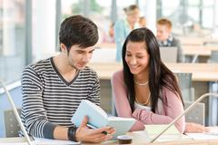 High school - two students read book Stock Photos