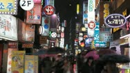 Seoul Neon Street Electronic by night, Asian Shopping, Shoppers, Time Lapse Stock Footage