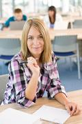 Happy smiling student study in classroom at university Stock Photos
