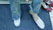 Stock Video Footage of Woman feet in new shoes and old pair stand near on carpet