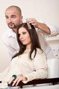 professional hairdresser choose hair dye color at salon - stock photo