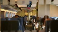 Stock Video Footage of People sit inside coach with digital screen under ceiling