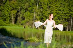 Stock Photo of beautiful romantic woman in summer sunny nature