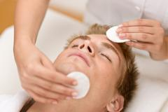 male cosmetics - cleaning face treatment - stock photo