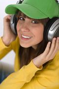 Happy female teenager enjoy music Stock Photos