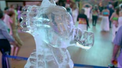 Ice sculpture of horsefish and many people dance at huge hall Stock Footage