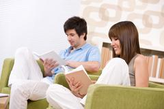 student - two teenager reading book home - stock photo