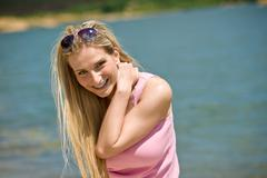 happy blond woman enjoy summer sun - stock photo