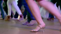 Many people dance in latin american style, only legs are visible - stock footage