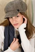 portrait of fashion model wearing cap - stock photo