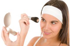 make-up skin care - woman apply powder - stock photo