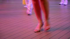 Woman makes steps during dance in latin american style Stock Footage