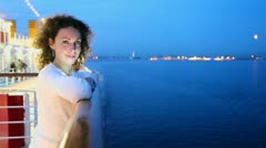 Woman stand on deck near fence and watch seascape during cruise Stock Footage