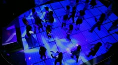 Lot of kids dance at discotheque in dark club, view from above - stock footage