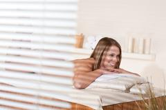 spa - young woman relax at wellness massage treatment - stock photo