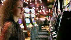 Woman pushes buttons on play machine and becomes happy when wins Stock Footage