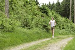 young man jogging in nature - stock photo