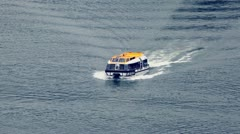 Motorized rescue boat floats fast by water surface at day Stock Footage