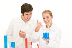 Scientists in laboratory test chemicals Stock Photos